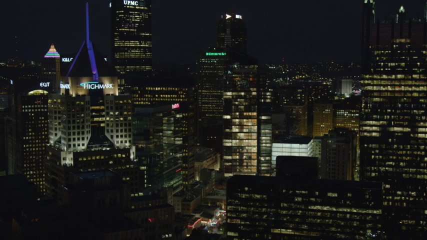 4K stock footage aerial video flying by Fifth Avenue Place, Downtown Pittsburgh, night Aerial Stock Footage | AX108_221