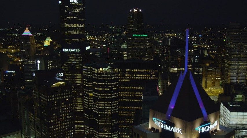 4K stock footage aerial video flying by skyscrapers, Downtown Pittsburgh, Pennsylvania, night Aerial Stock Footage | AX108_222
