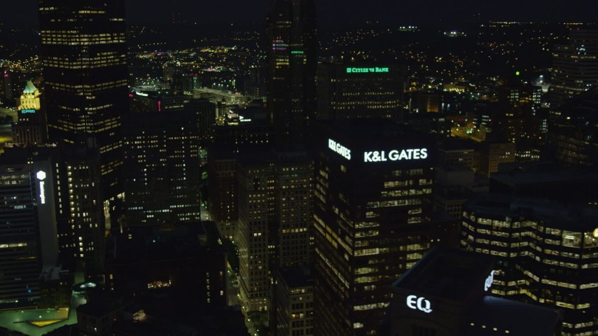 4K stock footage aerial video passing by skyscrapers, Downtown Pittsburgh, Pennsylvania night Aerial Stock Footage | AX108_223