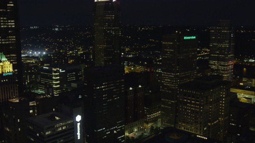 4K stock footage aerial video passing by skyscrapers revealing Gulf Tower, Downtown Pittsburgh, night Aerial Stock Footage | AX108_224