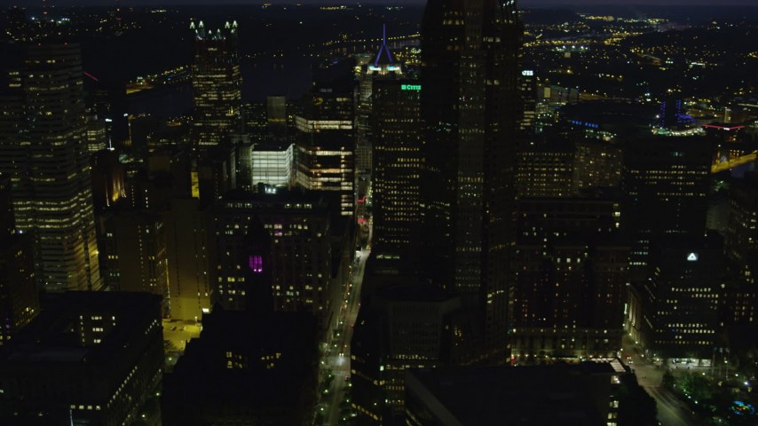 4K stock footage aerial video flying by city streets and skyscrapers, Downtown Pittsburgh, Pennsylvania, night Aerial Stock Footage | AX108_227