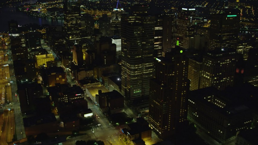 4K stock footage aerial video flying by skyscrapers and office buildings, Downtown Pittsburgh, Pennsylvania, night Aerial Stock Footage | AX108_228
