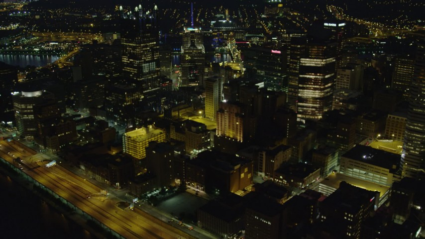 4K stock footage aerial video flying by office buildings while approaching PPG Place, Downtown Pittsburgh, night Aerial Stock Footage | AX108_229
