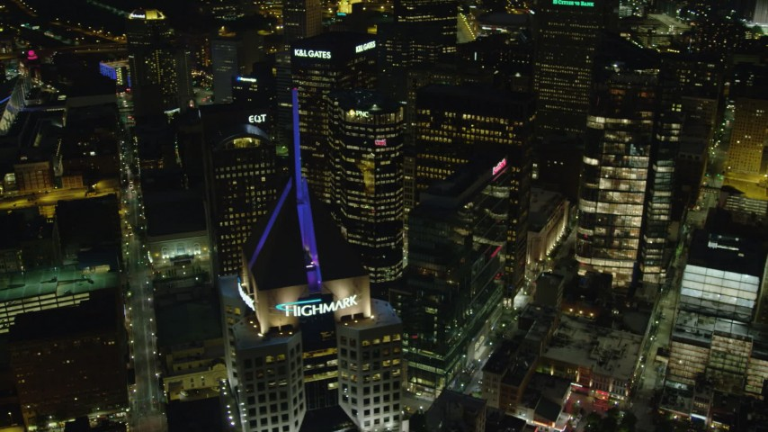 4K aerial video flying away from Fifth Avenue Place, Downtown Pittsburgh, night Aerial Stock Footage | AX108_232