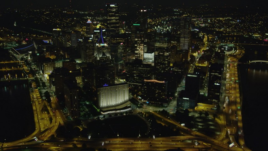 4K stock footage aerial video flying over Downtown Pittsburgh, Pennsylvania, night Aerial Stock Footage   AX108_236