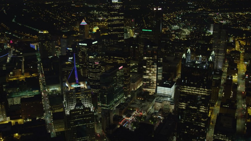 4K stock footage aerial video flying through the center of Downtown Pittsburgh, Pennsylvania, night Aerial Stock Footage | AX108_237