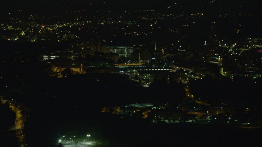 4K stock footage aerial video approaching VA Pittsburgh Healthcare System, Pittsburgh, night Aerial Stock Footage | AX108_240