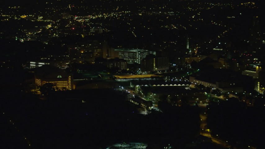 4K stock footage aerial video approaching VA Pittsburgh Healthcare System, Pittsburgh, night Aerial Stock Footage | AX108_241