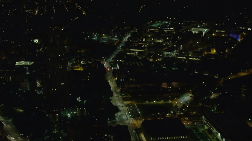 4K stock footage aerial video approaching Carnegie Mellon University, Pittsburgh, Pennsylvania, night Aerial Stock Footage | AX108_244