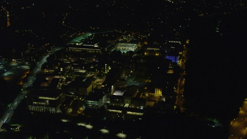 4K stock footage aerial video approaching Carnegie Mellon University, Pittsburgh, Pennsylvania, night Aerial Stock Footage | AX108_245