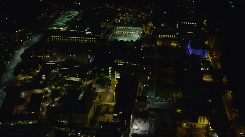 4K stock footage aerial video tilting down on the Carnegie Mellon University campus, Pittsburgh, Pennsylvania, night Aerial Stock Footage | AX108_246