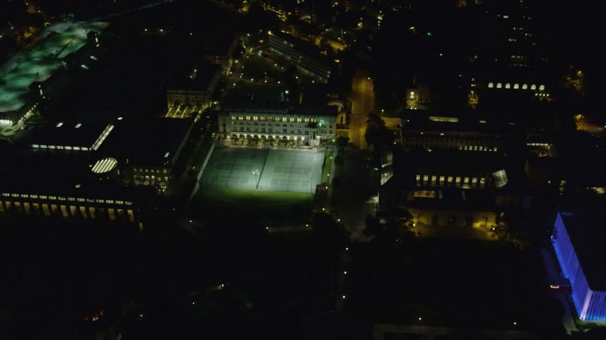 4K stock footage aerial video flying over Carnegie Mellon University campus buildings, Pittsburgh, night Aerial Stock Footage | AX108_247