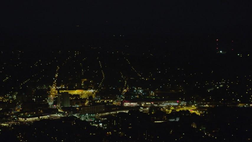 4K stock footage aerial video flying by residential neighborhoods, Pittsburgh, Pennsylvania, night Aerial Stock Footage   AX108_249