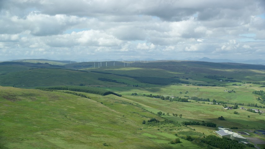 6K stock footage aerial video of windmills and farms, Denny, Scotland Aerial Stock Footage   AX109_005