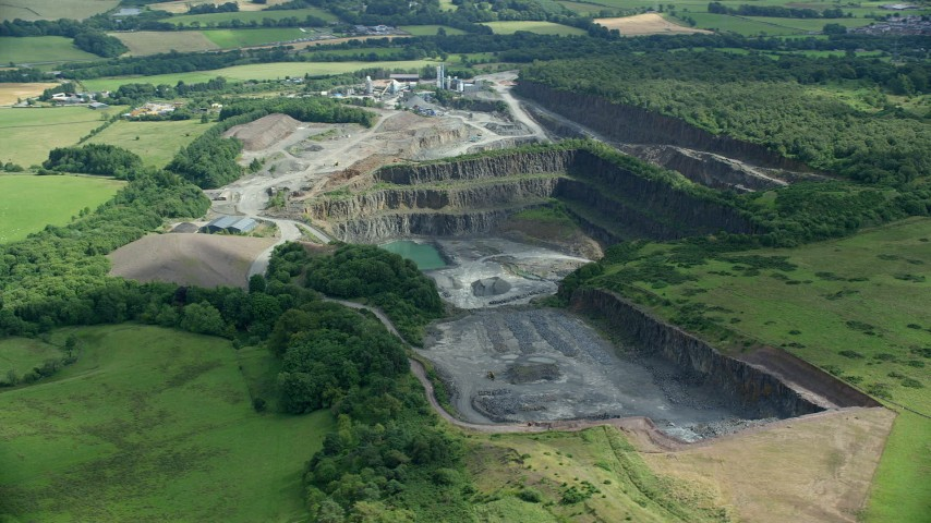 6K stock footage aerial video orbit quarry surrounded by farmland, Denny, Scotland Aerial Stock Footage   AX109_009