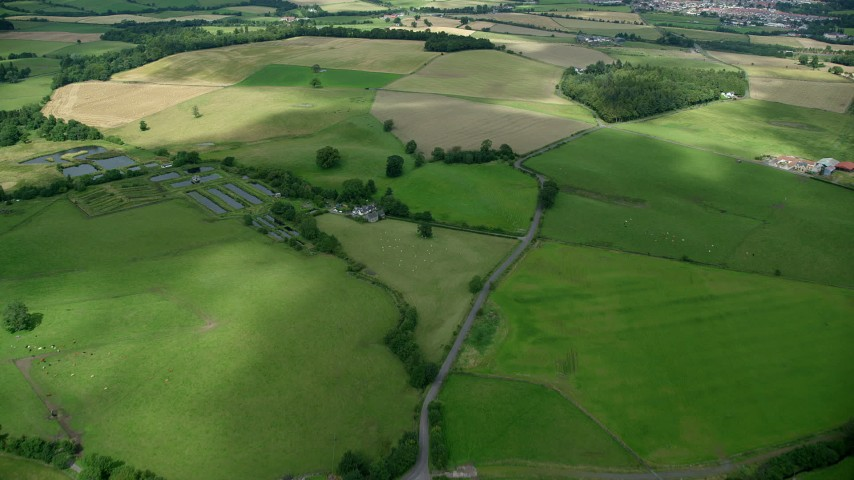 6K stock footage aerial video fly over farms and farmland; Stirling, Scotland Aerial Stock Footage | AX109_010
