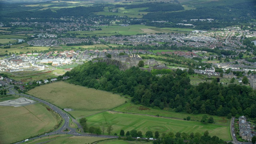 6K stock footage aerial video of Stirling Castle and residential area in Stirling, Scotland Aerial Stock Footage | AX109_015