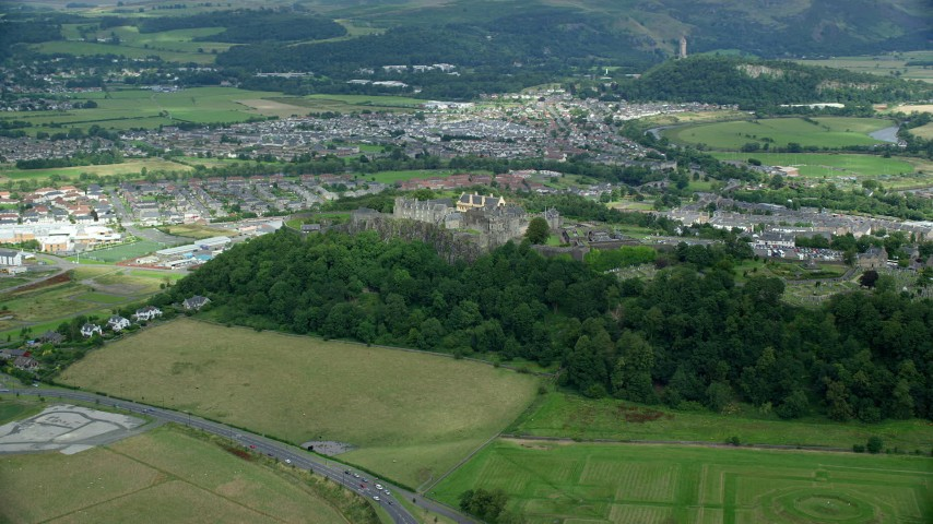 6K stock footage aerial video orbit of Stirling Castle and residential neighborhoods, Stirling, Scotland Aerial Stock Footage | AX109_016