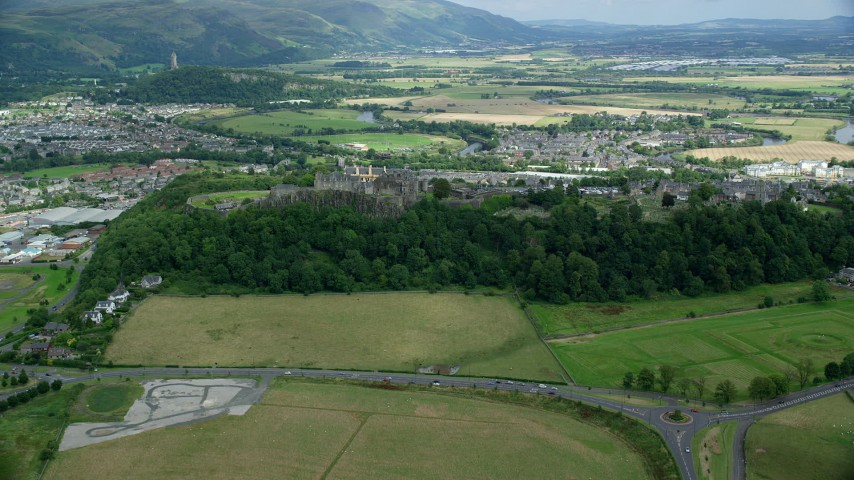 6K stock footage aerial video of flying away from Stirling Castle and residential area, Scotland Aerial Stock Footage | AX109_017