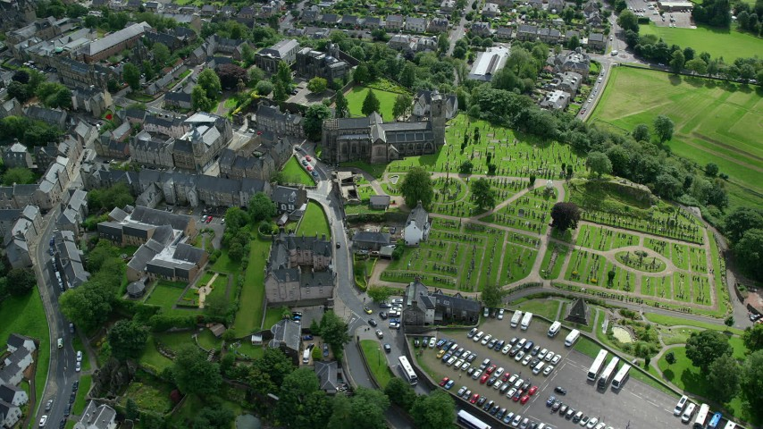 6K stock footage aerial video orbit church and cemetery by residential area, Stirling, Scotland Aerial Stock Footage | AX109_026