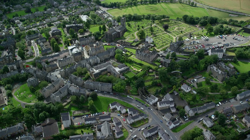 6K stock footage aerial video of a church and cemetery near residential area, Stirling, Scotland Aerial Stock Footage | AX109_027