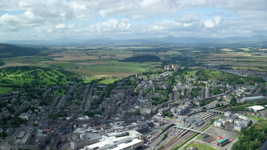 6K stock footage aerial video of historic Stirling Castle and residential area, Scotland Aerial Stock Footage | AX109_029