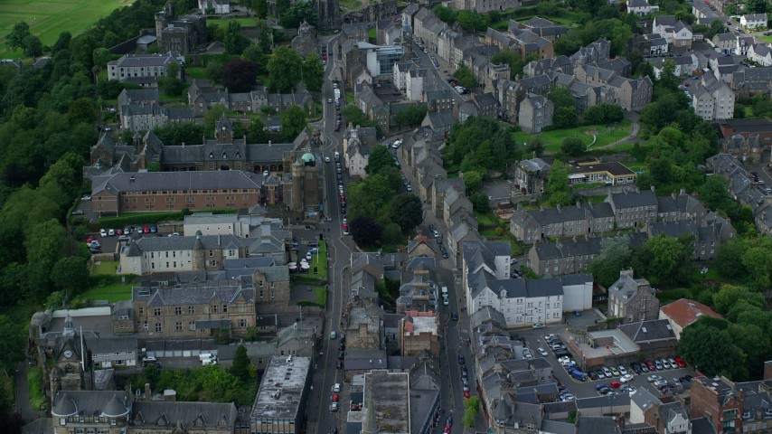 6K stock footage aerial video of apartment buildings and shops in Stirling, Scotland Aerial Stock Footage | AX109_032