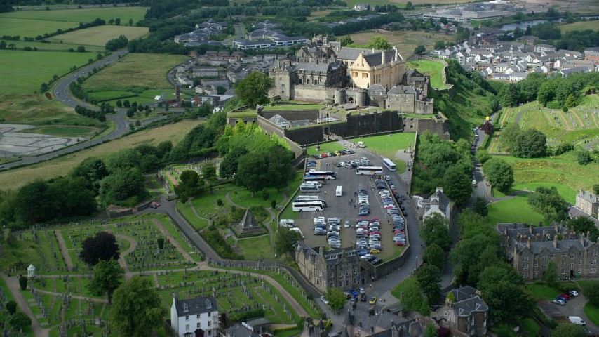6K stock footage aerial video fly over church and cemetery, approach Stirling Castle, Scotland Aerial Stock Footage   AX109_034