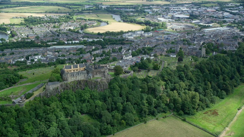 6K stock footage aerial video of Stirling Castle on a tree covered hill, Scotland Aerial Stock Footage | AX109_037