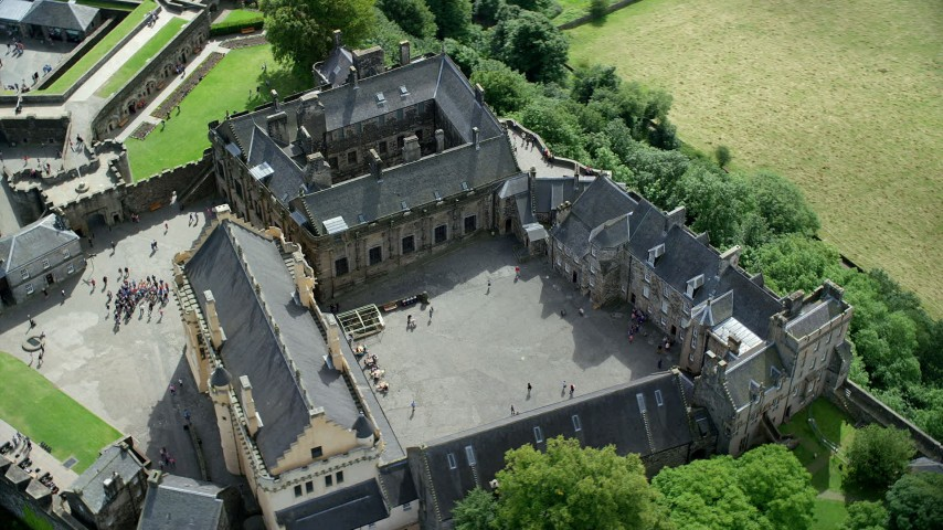 6K stock footage aerial video orbiting historic Stirling Castle and grounds with tourists, Scotland Aerial Stock Footage | AX109_042