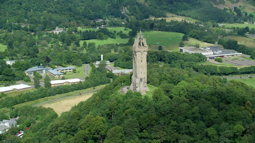 6K stock footage aerial video of Wallace Monument and hilltop trees, Stirling, Scotland Aerial Stock Footage | AX109_048