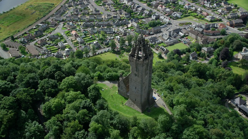 6K stock footage aerial video of orbiting historic Wallace Monument surrounded with trees, Stirling, Scotland Aerial Stock Footage | AX109_051