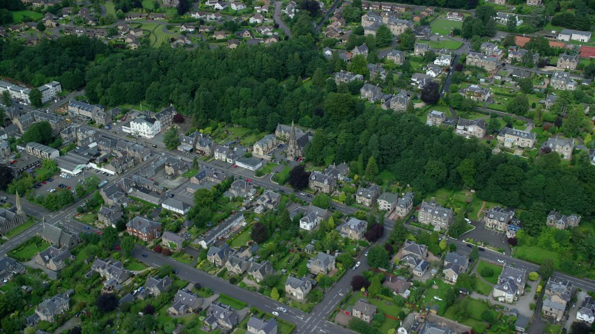 6K stock footage aerial video of a residential neighborhood and trees, Stirling, Scotland Aerial Stock Footage | AX109_057