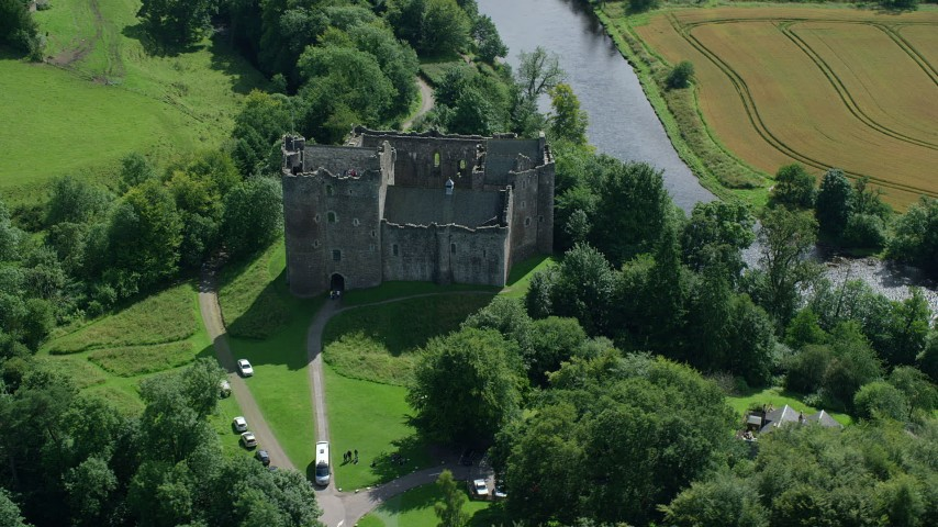 6K stock footage aerial video of orbiting Doune Castle and a river, Scotland Aerial Stock Footage | AX109_068
