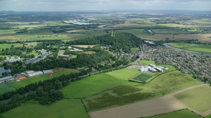 6K stock footage aerial video approach Wallace Monument and residential area, Scotland Aerial Stock Footage | AX109_097