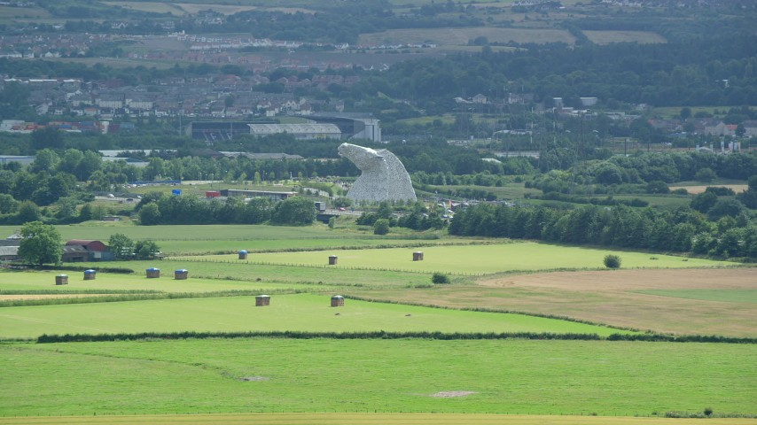 6K stock footage aerial video approach The Kelpies sculptures from farmland, Falkirk Scotland Aerial Stock Footage | AX109_117