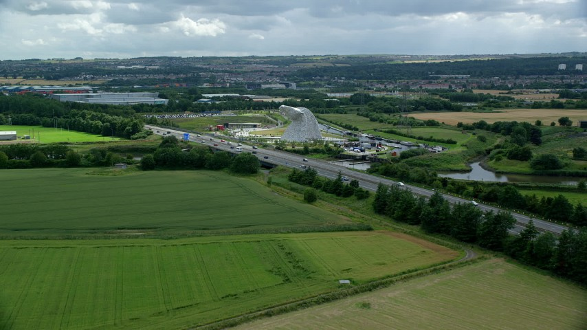 6K stock footage aerial video approach The Kelpies sculptures and M9 highway, Falkirk, Scotland Aerial Stock Footage | AX109_122