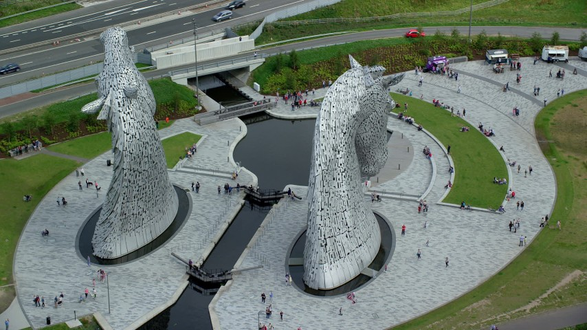 6K stock footage aerial video of orbiting The Kelpies sculptures with tourists in Falkirk, Scotland Aerial Stock Footage | AX109_126