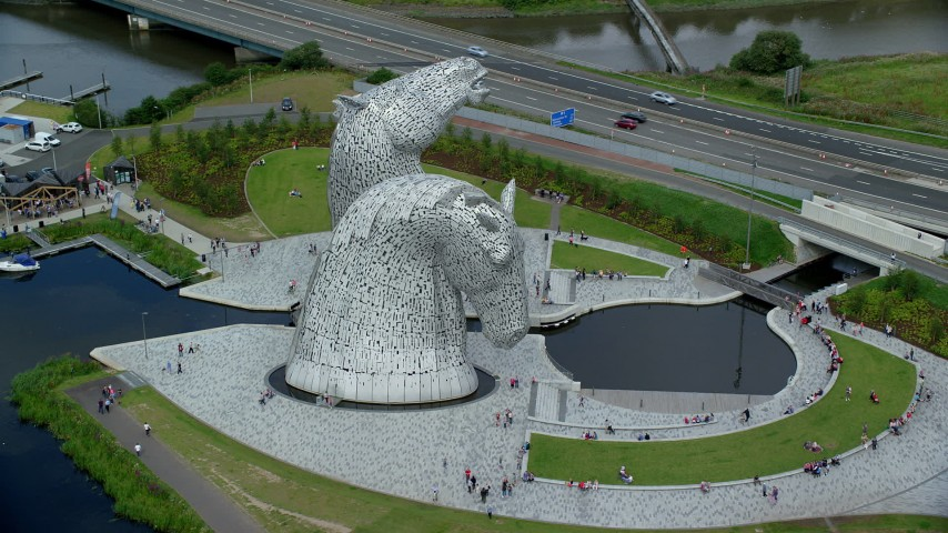 6K stock footage aerial video of orbiting The Kelpies sculptures in Falkirk, Scotland Aerial Stock Footage | AX109_128