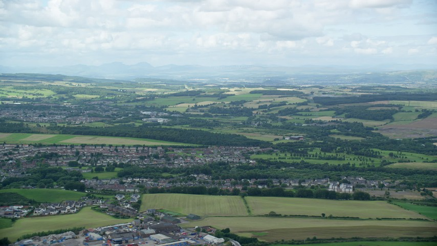 6K stock footage aerial video of farms and a Scottish village, Bonnybridge, Scotland Aerial Stock Footage | AX109_165