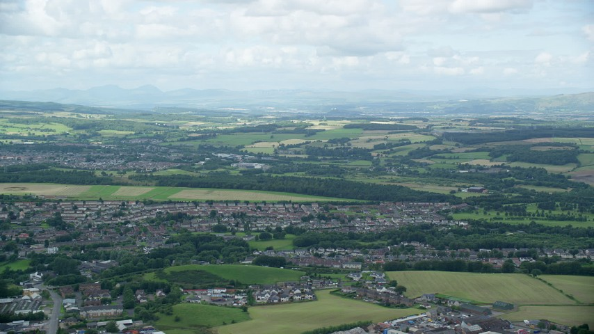 6K stock footage aerial video of farmland and a Scottish village, Bonnybridge, Scotland Aerial Stock Footage | AX109_166