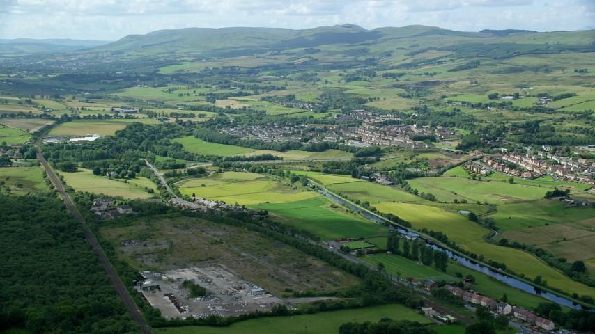 6K stock footage aerial video of Scottish farm fields near a village, Bonnybridge, Scotland Aerial Stock Footage | AX109_169