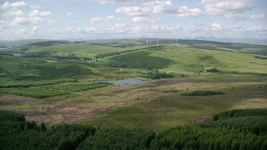 6K stock footage aerial video approach Buckleburn Reservoir and farm fields, Denny, Scotland Aerial Stock Footage | AX110_007