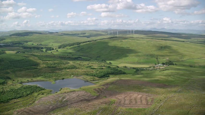 6K stock footage aerial video of Buckleburn Reservoir and farmland, Denny, Scotland Aerial Stock Footage | AX110_008