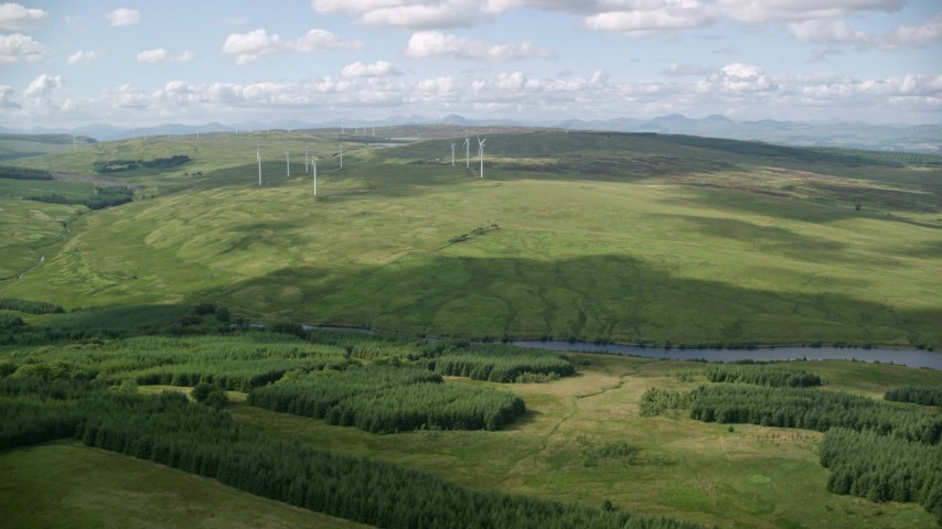 6K stock footage aerial video approach windmills in green countryside, Denny, Scotland Aerial Stock Footage | AX110_011