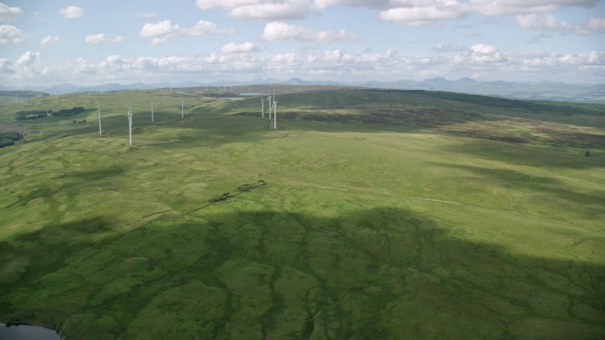 6K stock footage aerial video of an approach to windmills and a green countryside, Denny, Scotland Aerial Stock Footage | AX110_012