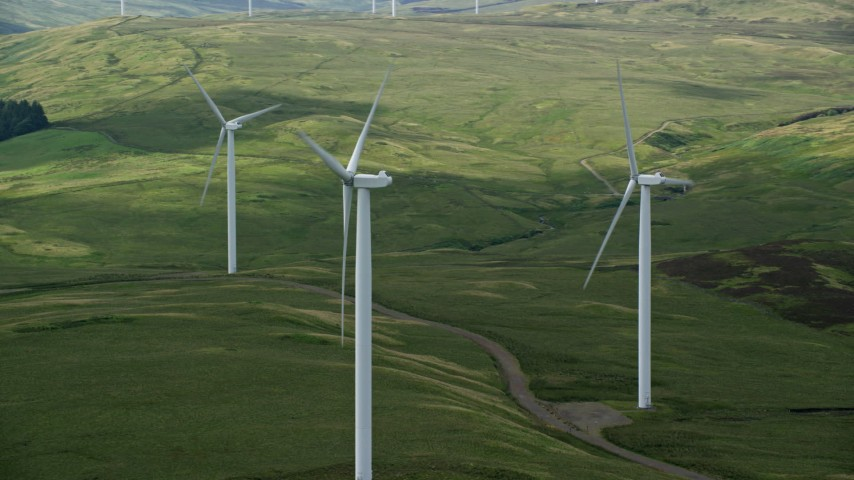 6K stock footage aerial video of windmills on green countryside, Denny, Scotland Aerial Stock Footage   AX110_014