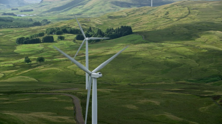 6K stock footage aerial video of windmills and green countryside, Denny, Scotland Aerial Stock Footage   AX110_015