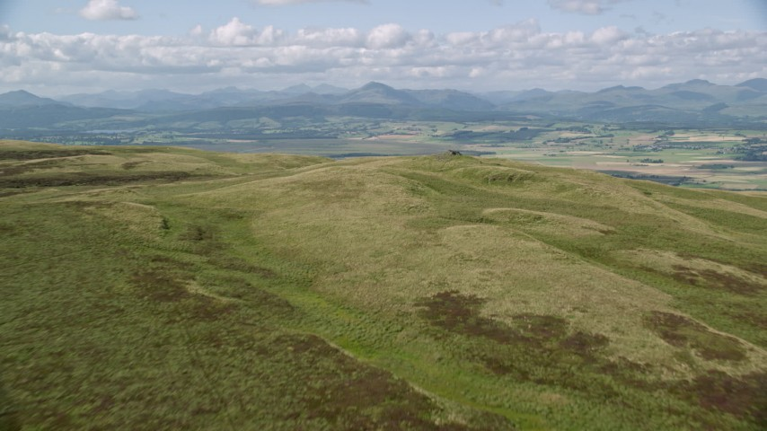 6K stock footage aerial video approach Carleatheran from the Gargunnock Hills, Scotland Aerial Stock Footage | AX110_026