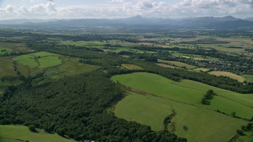 6K stock footage aerial video approach farm fields and forests, Kippen, Scotland Aerial Stock Footage | AX110_029